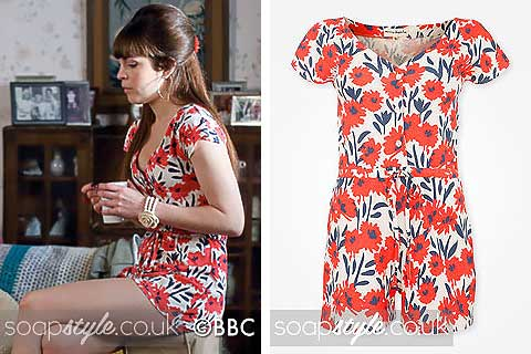 Picture of Poppy Meadow wearing her red floral playsuit in EastEnders