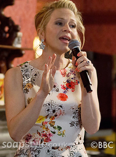 Picture of Linda Carter (Kellie Bright) wearing her floral peplum top in EastEnders