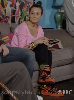 Picture of Tina Carter wearing her orange tiger trainers in EastEnders