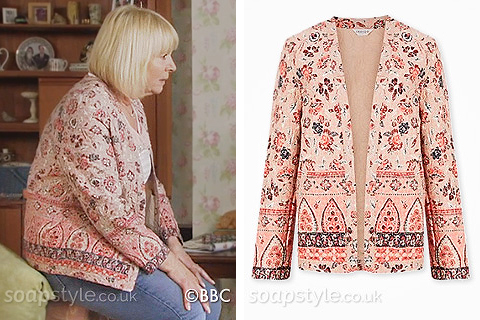 Picture of Pam Coker wearing her dark pink floral jacket in EastEnders