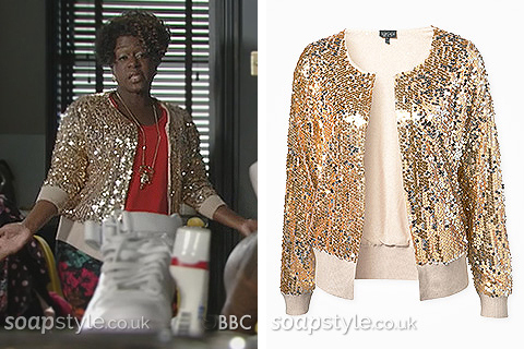 Picture of Kim Fox wearing her gold sequin bomber jacket in EastEnders