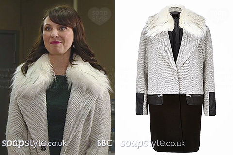 Picture of Honey wearing her grey faux fur collar coat in EastEnders