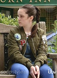 Amy's khaki green badge bomber jacket in Corrie - SoapStyle