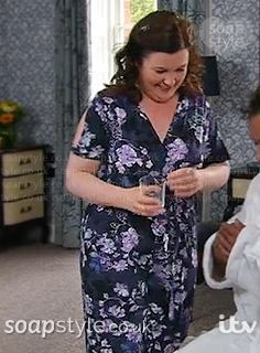 Mary's purple floral jumpsuit in Corrie - SoapStyle