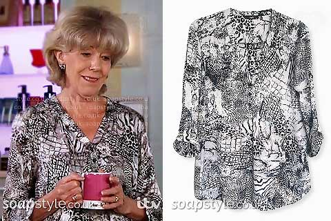 Picture of Audrey Roberts (Sue Nicholls) wearing her black and white mixed animal print blouse in Coronation Street