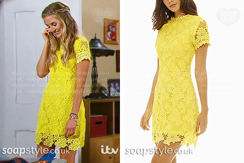 Picture of Holly Barton (Sophie Powles) wearing her yellow lace dress in Emmerdale