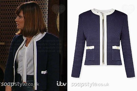 Chrissie wearing her white and navy blue jacket in Emmerdale