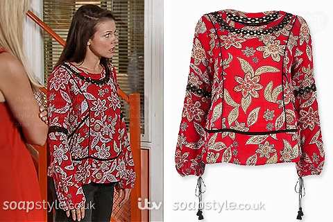 Kate Connor wearing her red floral top in Coronation Street