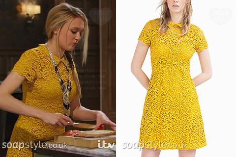 Picture of Rebecca wearing her yellow lace dress in the TV Soap Emmerdale