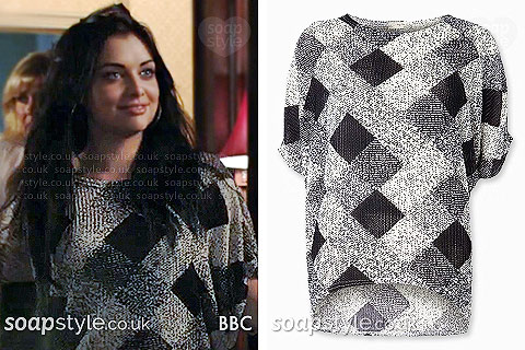 Whitney Carter (Dean) wearing her grey diamond jumper in EastEnders