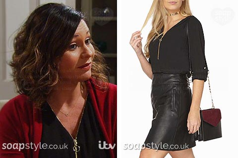 Chas Dingle wearing her black zip neck blouse in Emmerdale