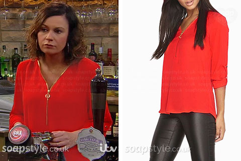 Chas Dingle wearing her red zip neck blouse in last night's Emmerdale