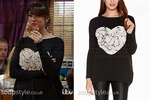 Kerry Wyatt wearing her black heart jumper in Emmerdale