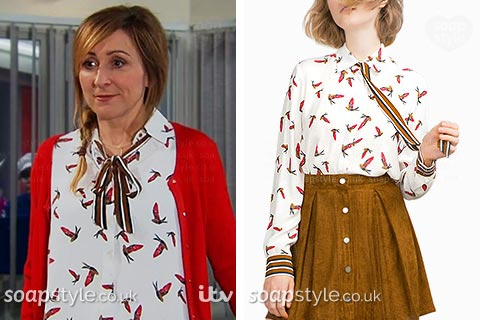 Laurel wearing her parrot print shirt with tie neck in Emmerdale