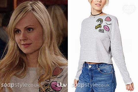 Sarah-Louise Platt wearing her grey patch shoulder badge sweatshirt/jumper in Coronation St