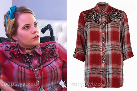 Courtney Campbell wearing a red tartan print shirt in Hollyoaks