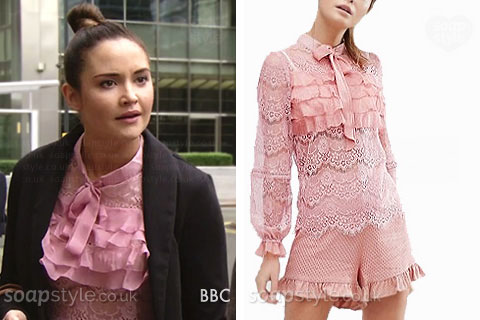 Lauren Branning wearing a pink lace bow blouse in EastEnders