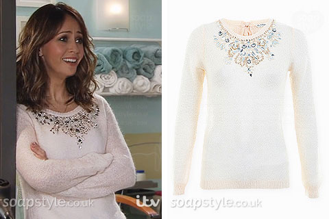 Maria Connor wearing a pink jewel embellished neck jumper in Coronation Street
