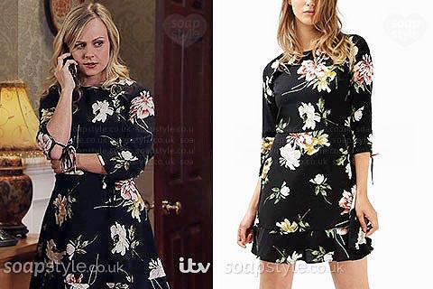 Sarah Platt wearing a black floral tea dress in Coronation Street