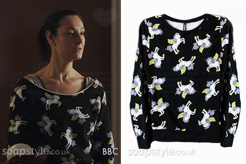 Tina Carter wearing a unicorn print sweater in EastEnders