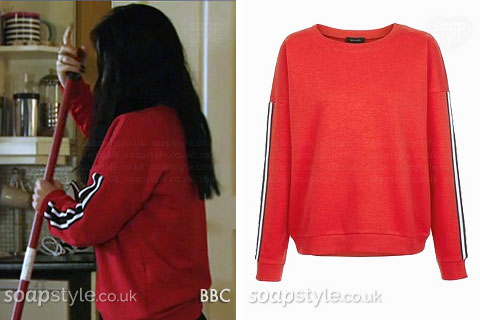 Whitney Carter (Dean) wearing a red stripe sleeve sweater in EastEnders