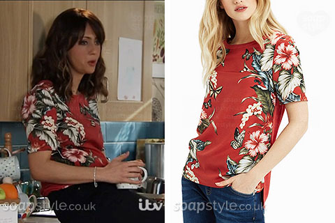 Maria Connor wearing a red top with tropical flowers in Coronation Street