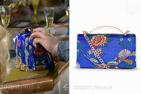 Nancy Osborne's blue satin flower handbag in Hollyoaks