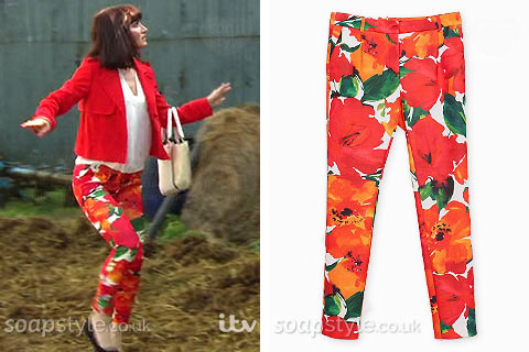 Leyla Harding wearing red orange flower print trousers on TV in Emmerdale