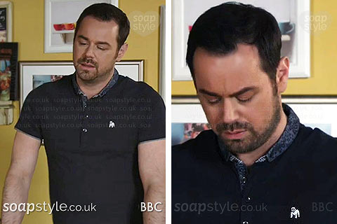 Mick Carter (Danny Dyer) wearing a blue top with white bulldog on TV in EastEnders