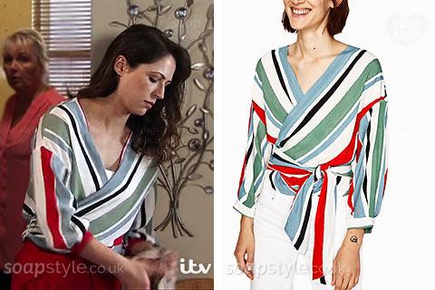 Nicola Rubinstein's (Phelan's daughter) wearing her stripe wrap blouse in Coronation Street