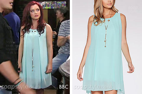 Whitney (Shona McGarty) wearing a necklace tunic dress in EastEnders