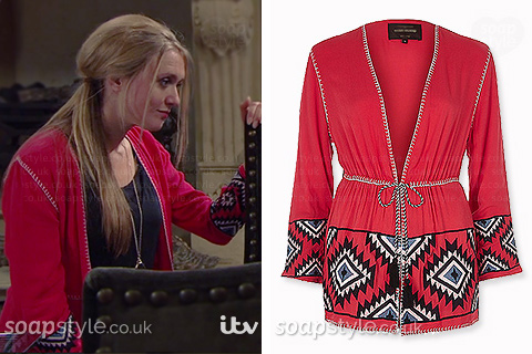 Rebecca White (Emily Head) wearing her red kimono jacket on TV in Emmerdale