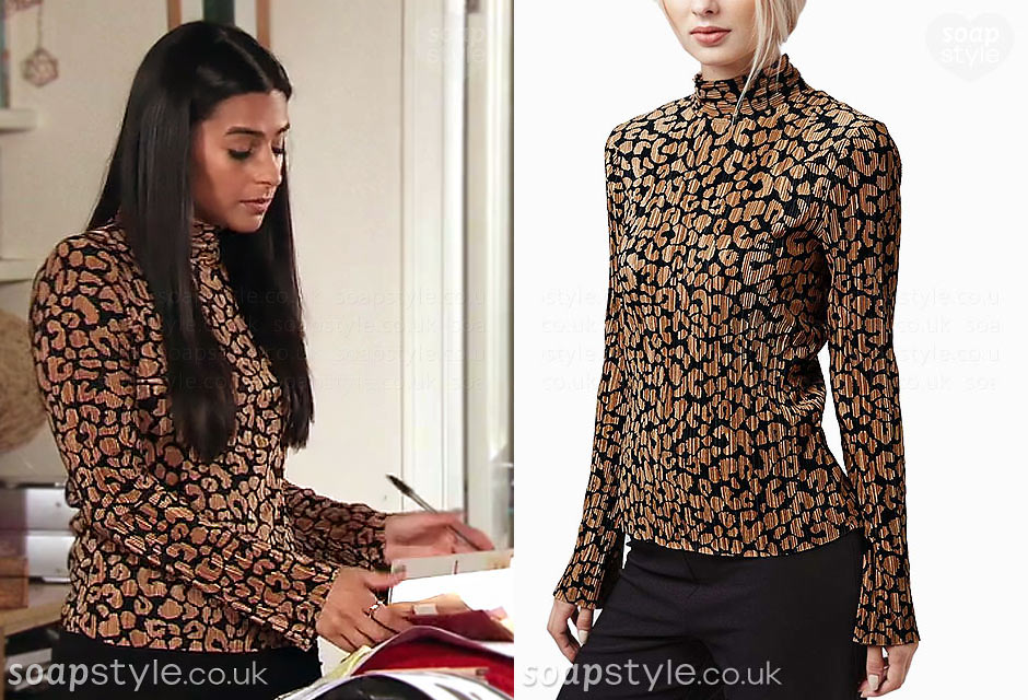 Alya Nazir wearing an animal print top with turtle neck on TV in Coronation Street