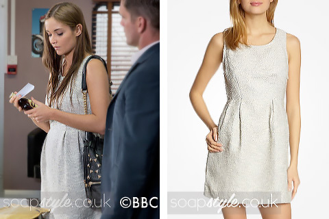 Lauren Branning wearing a grey cutout dress in EastEnders