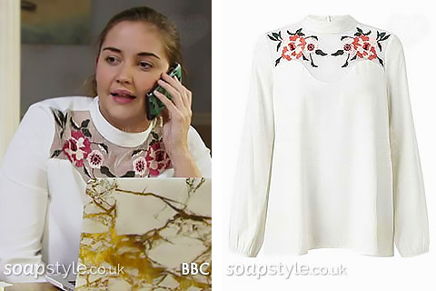 White embroidered flower mesh high neck blouse worn by Lauren in EastEnders