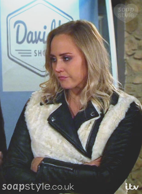 Tracy wearing a cream fur coat with black faux leather sleeves in Emmerdale