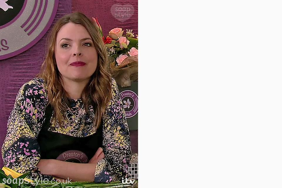 Tracy Barlow wearing a yellow and purple wild flower print top in Coronation Street